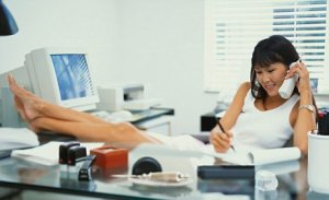 Woman Lounging at Office Desk ca. 2001